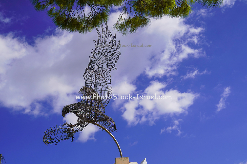 Wire sculpture of a flying eagle by Spiros Mourmouzis of Argostoli  on a marble base at Pastra, Cephalonia, Greece
