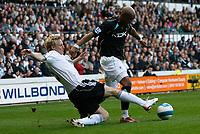 Photo: Steve Bond.<br />Derby County v Bolton Wanderers. The FA Barclays Premiership. 29/09/2007.Gary Teale (L) slides in on  El-Hadj Diouf (R)
