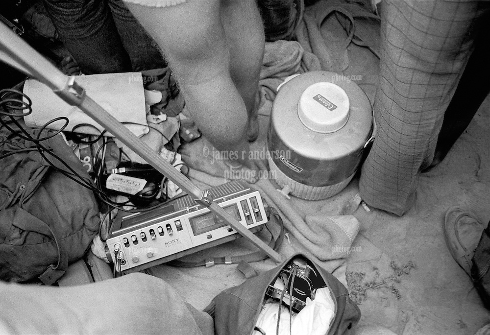 Sony TC-152SD Cassette Deck recording the Grateful Dead Concert at Dillon Stadium on 31 July 1974. My Camera bag is at my right foot, a cooler and some of my friends legs & feet. Photograph taken with a Hasselblad Camera with Kodak Tri-X B&W film. At this time the deck of choice was the Sony 152 (levels look about right here). That machine is in my studio right now. Pete Z has the masters.