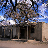 USA, New Mexico, Santa Fe. Humble building hosts an artisan shop in San Ildefonso Pueblo.