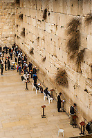 Jewish men praying in the men's section of the Western Wall (Wailing Wall), the Temple Mount, Old City, Jerusalem, Israel.