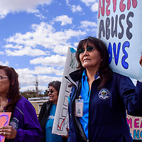 Althea James, right, and Lorena Halwood lead a protest against rape and sexual abuse outside the Navajo Nation Council Chambers in Window Rock Tuesday.