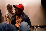 Farouk arrived in Johannesburg from Zimbabwe 4 days before this photo was shoot with his wife and his 3 years old son. He is a former book keeper and he hope to use his skills to find a job in South Africa.