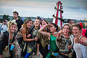 Glastonbury Festival, 2015.<br /> Happy group of friends setting out for a night's partying.