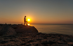 THEMENBILD - Silhouette eines Mannes am Strand bei Sonnenaufgang an einem heissen Sommertag, aufgenommen am 17. August 2018 in Larnaka, Zypern // Silhouette of a man on the beach at sunrise on a hot summer day, Larnaca, Cyprus on 2018/08/17. EXPA Pictures © 2018, PhotoCredit: EXPA/ JFK