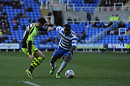 Yeovil Town's Tom Lawrence challenges Royston Drenthe of Reading for the ball during the Skybet championship match, Reading v Yeovil Town at the Madejski Stadium in Reading, Berkshire on Saturday 1st March 2014.<br /> pic by Jeff Thomas, Andrew Orchard sports photography.