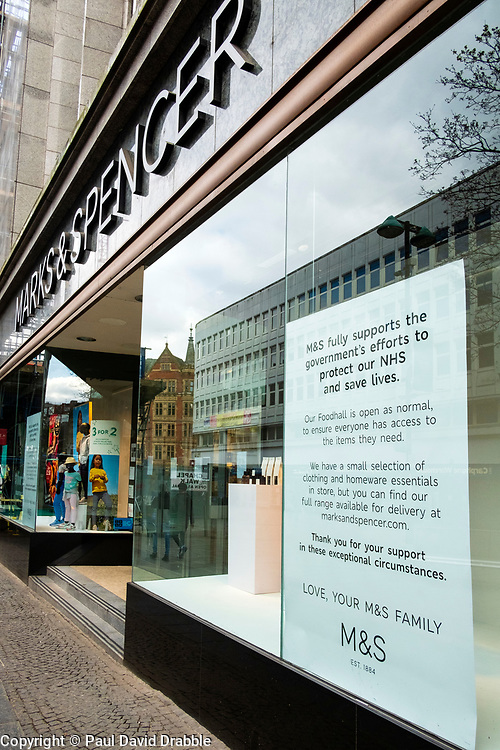 Sheffield UK Friday 3 April 2020 <br /> Large Coronavirus Covid-19  notice in the windows of Marks and Spencer on Fargate Sheffield <br /> <br /> 3 April 2020<br /> <br /> www.pauldaviddrabble.co.uk<br /> All Images Copyright Paul David Drabble - <br /> All rights Reserved - <br /> Moral Rights Asserted -