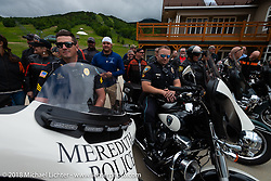 Riders pose with the police escort on the Gypsy Tour ride to the Gunstock resort during Laconia Motorcycle Week. NH, USA. Thursday, June 14, 2018. Photography ©2018 Michael Lichter.