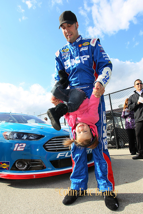 during qualifying for the NASCAR Sprint Cup race at Kansas Speedway, Friday, April 19, 2013 in Kansas City, Kansas. (AP Photo/Colin E. Braley)