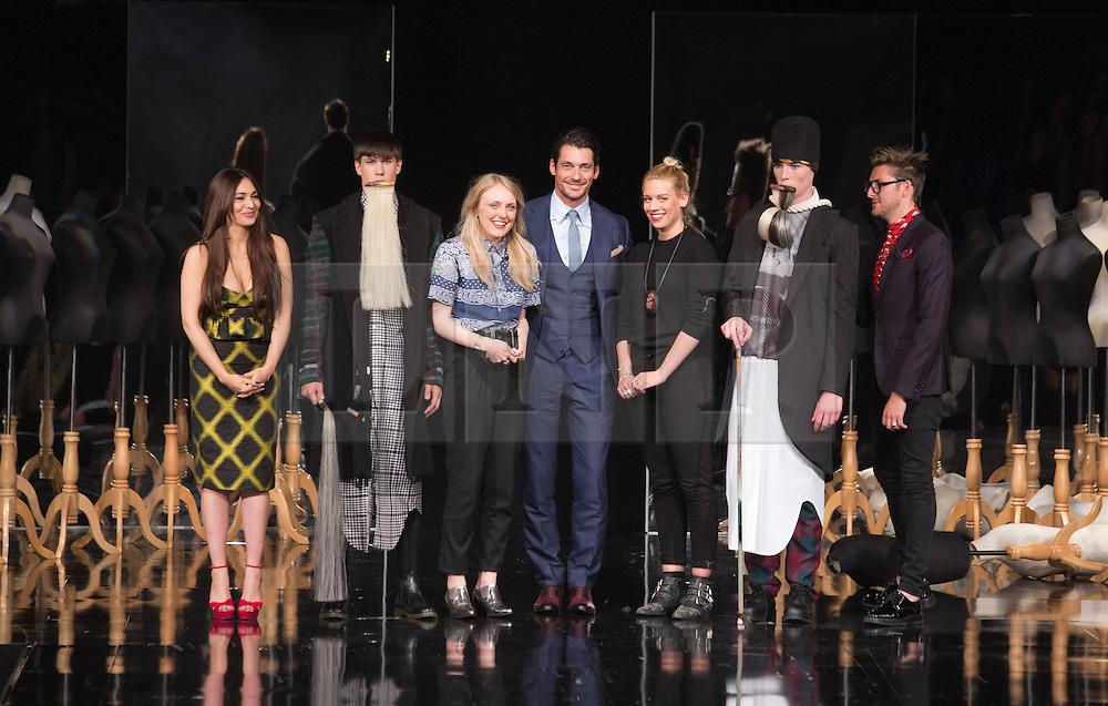 © Licensed to London News Pictures. 05/06/2013. London, England. SHAUNI DOUGLAS & OLIVIA CREBER, Edinburgh College of Art, win the Menswear Award. Pictured with David Gandy, Award winners of Graduate Fashion Week 2013. Photo credit: Bettina Strenske/LNP