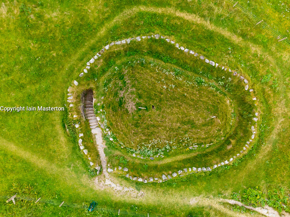 Aerial view from drone of reconstructed Iron Age house at Bosta on Great Bernera , Isle of Lewis, Outer Hebrides, Scotland, UK