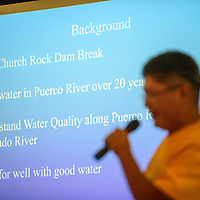 072315  Adron Gardner/Independent<br /> <br /> A projected slide with information on the Churchrock uranium spill backdrops Tommy Rock of To Lani Enterprises at the Nahata Dziil Chapter House in Sanders Friday.