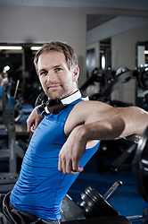 Mid adult man taking a break in the gym, Bavaria, Germany
