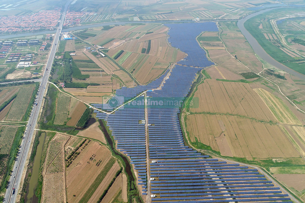 June 15, 2018 - Binzhou, Binzhou, China - Binzhou, CHINA-14th June 2018: People combines the development of photovoltaic power plant with duck breeding in Binzhou, east China's Shandong Province, June 14th, 2018. (Credit Image: © SIPA Asia via ZUMA Wire)