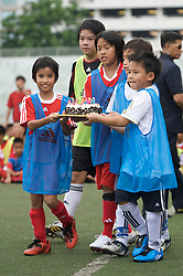 BANGKOK, THAILAND - Tuesday, July 21, 2009: Thai children bring out a bithday cake for Liverpool's Dirk Kuyt (who's birthday is tomorrow, July 22nd) during a kids training session sponsored by Adidas at the Chulalong Stadium during the team's preseason tour of Asia. (Pic by David Rawcliffe/Propaganda)