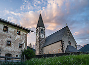 Church in Santa Maddalena village, Val di Funes (Villnöss), Dolomites, Italy, Europe. See the valley and municipality of Funes (Villnöss) in Trentino-Alto Adige/Südtirol (South Tyrol), Italy. Enjoy great hiking here in the vast Nature Park of Parco Naturale Puez-Odle (German: Naturpark Puez-Geisler; Ladin: Parch Natural Pöz-Odles). The Dolomites are part of the Southern Limestone Alps, Europe. UNESCO honored the Dolomites as a natural World Heritage Site in 2009.