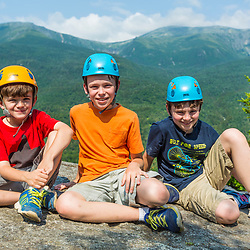 (from left to right) Nate, Will, and Owen Tuttle, at the top of Square Ledge in New Hampshire's White Mountains. Mount Washington is in the distance.