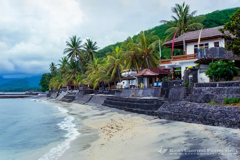 Bali, Karangasem, Candidasa. The beach looking west.