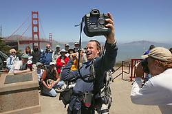 Photographer Taking Selfie Of Coastwalk Team Members Group Photo On San Francisco Side Of Golden Gate Bridge