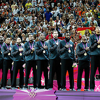 12 August 2012: Team USA stand during the National Anthem wearing gold medals following the 107-100 Team USA victory over Team Spain, during the men's Gold Medal Game, at the North Greenwich Arena, in London, Great Britain.