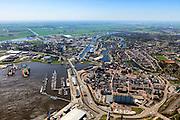Nederland, Groningen, Delfzijl, 01-05-2013; overzicht centrum van Delfzijl, gezien naar Eemskanaal. Links haven Delfzijl met droogdokken en jachthaven Neptunus. Eemskanaal.<br /> Town centre and Delfzijl harbor with docks and marina Neptune. In the background the Ems.<br /> luchtfoto (toeslag op standard tarieven);<br /> aerial photo (additional fee required);<br /> copyright foto/photo Siebe Swart