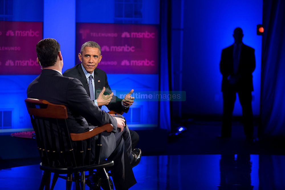 President Barack Obama and José Díaz-Balart participate in an immigration town hall hosted by Telemundo and MSNBC at Florida International University in Miami, Fla., Feb. 25, 2015. (Official White House Photo by Pete Souza)<br /> <br /> This official White House photograph is being made available only for publication by news organizations and/or for personal use printing by the subject(s) of the photograph. The photograph may not be manipulated in any way and may not be used in commercial or political materials, advertisements, emails, products, promotions that in any way suggests approval or endorsement of the President, the First Family, or the White House.