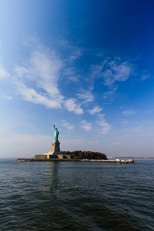 The Statue of Liberty on Liberty Island in New York Harbor, USA. The statue is an icon of freedom and of the United States: a welcoming signal to immigrants arriving from abroad.