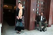 Fawzia Koofi, 35, MP and presidential candidate 2014, Kabul/Badakshan with bodyguard. Kabul, Afghanistan.