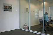 Working separately and alone in private cubicle of an auditing company at their London headquarters