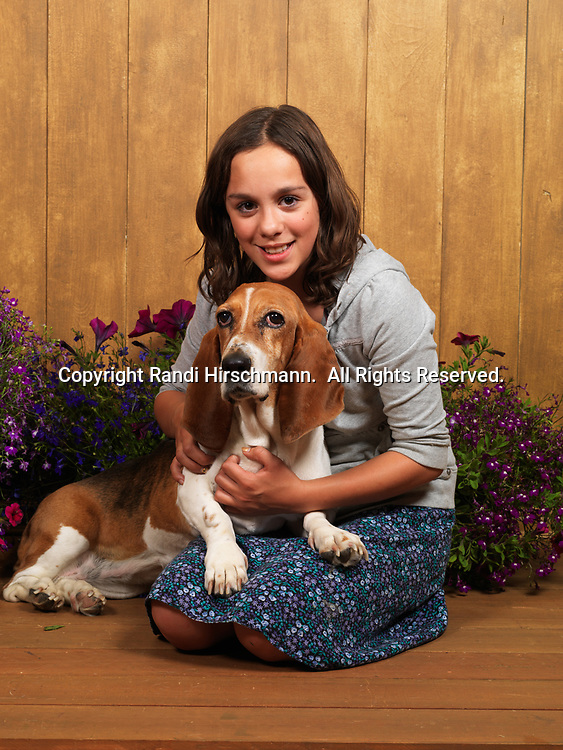 """Basset Hound, 12-year-old """"Hannah"""" with 11-year-old Ashley, photographed in Randi's Studio and owned by Kathyrn Torres of Peters Creek, Alaska.  (PR)"""