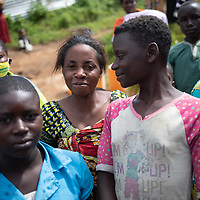 Women smile during an event to mark the opening of a small reservoir near Butembo, Congo. The Reservoir was part of an IMA and Tearfund project to support communities and strengthen basic health care during the Ebola crisis which ended in June 2020.