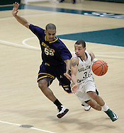 Marcus Henderson of Sullivan County Community College dribbles the ball past David Scott of Rochester (Minn.) Community & Technical College during a game in the NJCAA Division III national tournament in Loch Sheldrake on Friday, March 15, 2013.