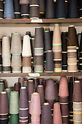 Spools of coloured cashmere wool in a workshop in Solomeo, Perugia, Italy