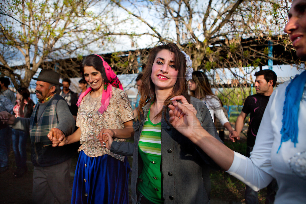 A recently eloped girl dancing. Each spring in Mogila, Bulgaria, is celebrated the Gypsy Bride Market. In this festival the virginity is for sale. The honor can be bought. Every girl has a price to be agreed between the parents of the girl and the candidate. The price can range between 1.500 and 10.000€, in a country where the minimum salary is just over 100€. The market joins the Kalajdzii families, known as the thracians tinkerers, whose tradition is still alive. Many girls dress as real princesses, others prefer to dress in a modern way. They dance during hours the ring dance while grandparents and parents watch the way the young interrelate. Many girls dream to be married by the rite imposed by the tradition. Nowadays there are some girls that don't agree with the tradition and would prefer not to marry, although they assist to these market all the times. Divorces and elopements, so far taboo, are becoming everytime more frequent. Beyond the topic, ethnologists, define it as the Kalajdzii's disco, where the family honor is involved in a commercial transaction. This ritual has being celebrated for years, so anthropologists think is not going to change too much in future.