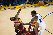 Cleveland Cavaliers forward LeBron James (23) runs into Golden State Warriors forward Draymond Green (23) at half court at Oracle Arena in Oakland, Calif., on January 16, 2017. (Stan Olszewski/Special to S.F. Examiner)