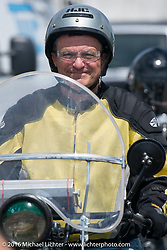 Clyde Crouch riding to the Daytona Speedway on the Thursday before the Friday start of the Motorcycle Cannonball Cross-Country Endurance Run. Daytona Beach, FL, USA. September 4, 2014.  Photography ©2014 Michael Lichter.