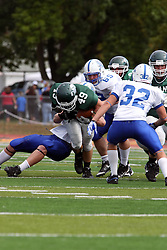 17 September 2011: Brandon Bettis and Kevin Glock team up to stop Cameron Blossom during an NCAA Division 3 football game between the Aurora Spartans and the Illinois Wesleyan Titans on Wilder Field inside Tucci Stadium in.Bloomington Illinois.