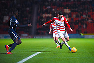 Danny Andrew of Doncaster Rovers (3) shapes to hit a cross into the box during the EFL Sky Bet League 1 match between Doncaster Rovers and Southend United at the Keepmoat Stadium, Doncaster, England on 12 February 2019.