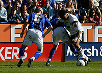 Photo: Steve Bond.<br />Leicester City v Derby County. Coca Cola Championship. 06/04/2007. Giles barnes (R) wins the ball. Danny Tiatto (L) watches