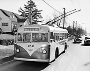 Y-480127-01.  Bus 152, Williams Avenue bus, trolley bus, electric wires, passengers boarding, driver at wheel.