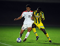 La Roche sur Yon FC Nantes v Korea  DPR 09/10/2009<br /> Pak Nam  Chol (DPR) Koita Ismail  (FC Nantes)<br /> North Korea make a rare appearance in the West having already qualified for World Cup 2010. Their last appearance in a major competiition was World Cup 1966 when they famously knocked Italy out of the tournament.<br /> Photo Roger Parker Fotosports International