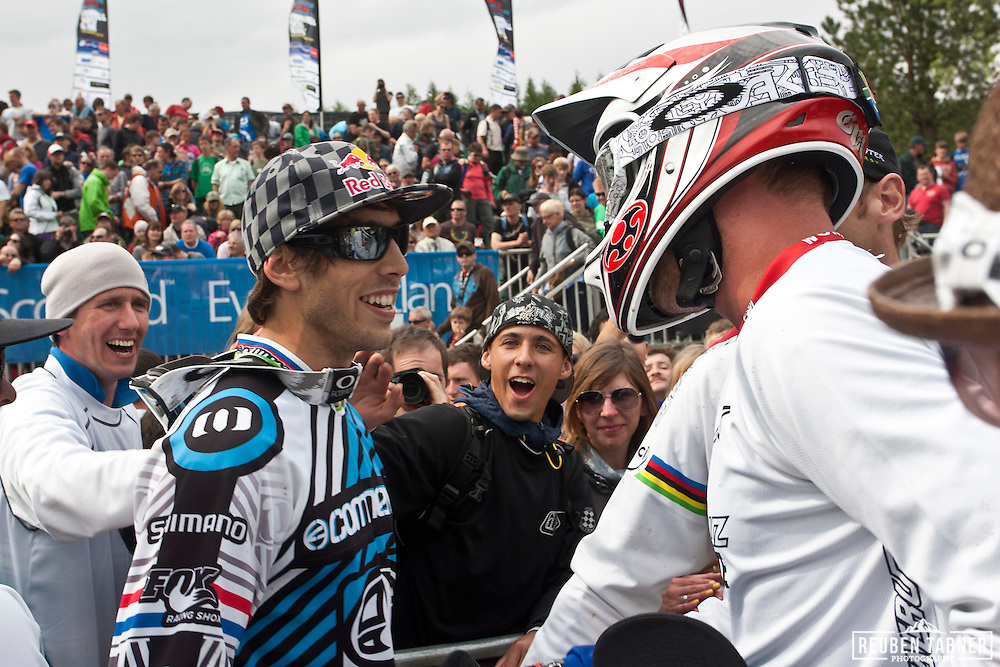 Gee Atherton (Great Britain) of team Commencal is congratulated by Greg Minnaar (South Africa) after winning the mens downhill at the UCI Mountain Bike World Cup in Fort William, Scotland.