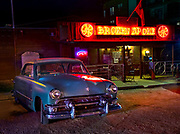 1950's Ford parked in front of the Broken Spoke, an iconic country and western dance hall in Austin.
