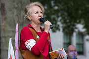 Dr Gail Bradbrook addresses activists from HS2 Rebellion, an umbrella campaign group comprising longstanding campaigners against the HS2 high-speed rail link as well as Extinction Rebellion activists, at a protest rally in Parliament Square on 4 September 2020 in London, United Kingdom. The rally, and a later protest action at the Department of Transport during which activists glued themselves to the doors and pavement outside and sprayed fake blood around the entrance, coincided with an announcement by HS2 Ltd that construction of the controversial £106bn high-speed rail link will now commence.