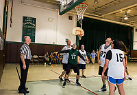 Gilford Police officer Curtis Mailloux has a little fun with his team mates and dons a Holy Trinity uniform during the community basketball game between Holy Trinity students and the Laconia Police Dept on Saturday morning.  (Karen Bobotas/for the Laconia Daily Sun)
