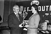 23/05/1963<br /> 05/23/1963<br /> 23 May 1963<br /> Esso Staff Golf Outing at Woodbrook Golf Club, Co. Dublin. Image from the prize giving after the event in the Golf Club. Mrs J. Donovan, wife of Esso Director, John Donovan, on right, presenting the  Esso Cup and Captains prize to Mr. T. Whelon, winner, from Cork.