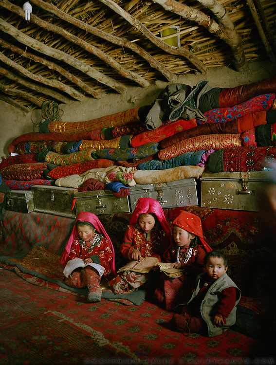 Girl learning to read Koran at Haji Osman:Bibi Hawa (11 yrs old), Marbet (6) and Chechen Gul (7). They start learning at 6 years old. They are taught only in winter 3 months/year..Campment of Tshar Tash (Haji Osman's camp), in the Wakhjir valley, at the source of the Oxus..Winter expedition through the Wakhan Corridor and into the Afghan Pamir mountains, to document the life of the Afghan Kyrgyz tribe. January/February 2008. Afghanistan valley, at the source of the Oxus..Winter expedition through the Wakhan Corridor and into the Afghan Pamir mountains, to document the life of the Afghan Kyrgyz tribe. January/February 2008. Afghanistan