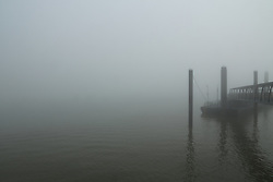© Licensed to London News Pictures. 05/09/2013. Kent was hit by a blanket of thick fog this morning. These photos show the low visibility at riverside Gravesend, not far from the Isle of Sheppey where a major traffic incident where the fog is thought to have been a contributing factor. credit : Rob Powell/LNP