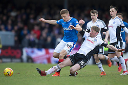 Rangers' Greg Docherty (left) and Ayr United's Jamie Adams battle for the ball during the William Hill Scottish Cup, fifth round match at Somerset Park, Ayr.