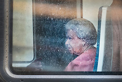 © Licensed to London News Pictures. 20/12/2019. London, UK. Queen Elizabeth II looks out through a rainy window as she begins her journey by train from King's Cross station in London to Sandringham for her Christmas break. Photo credit: LNP